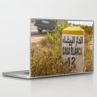 casablanca Laptop & iPad Skins featuring Casablanca milestone with old Volkswagen microbus by Premium