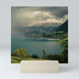 arising storm over lake lucerne Mini Art Print