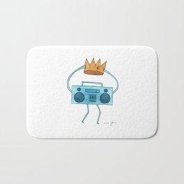 boombox holding a paper crown Bath Mat