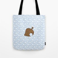 animal crossing Tote Bags featuring Animal Crossing Winter Leaf by Rebekhaart