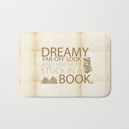 beauty and the beast... with her nose stuck in a book quote Bath Mat