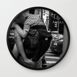 Mother Carrying her Son on her Back, A Wall Clock