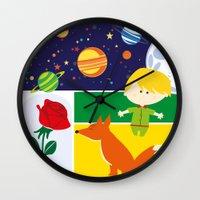 le petit prince Wall Clocks featuring Le Petit Prince by Lara Brambilla
