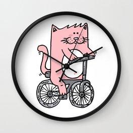 Cute pink cat riding the bike Wall Clock