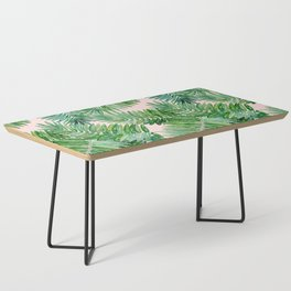 Green palm leaves on a light pink background. Coffee Table