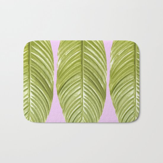 Three large green leaves on a pink background - vivid colors Bath Mat