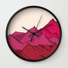 The falling snow and the mountains Wall Clock