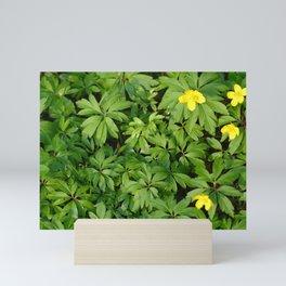 Yellow flowers on Green Mini Art Print