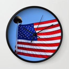 United States flag waving with a military helmet on the mast Wall Clock