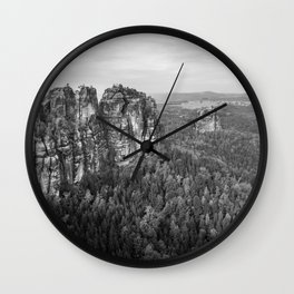 Rocks above the forest Wall Clock
