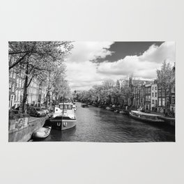 Boats on Amsterdam canal Rug