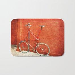 Red Tall Bike Against Brick Wall Bath Mat