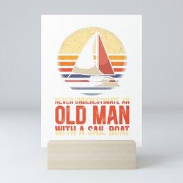 An old man with a sail boat Mini Art Print