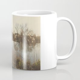 A cottage along a river Coffee Mug