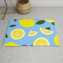 Lemons on blue background Rug