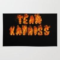 katniss Area & Throw Rugs featuring Team Katniss by pirateprincess
