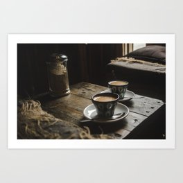 Warm tones of cafe with 2 cups of espresso coffee in hand-painted blue mugs Art Print