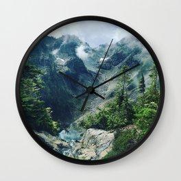 Mountain through the clouds Wall Clock