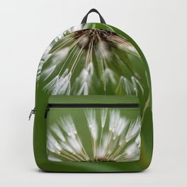 Dandelion over green background Backpack