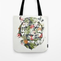 tropical Tote Bags featuring Tropical tiger by Robert Farkas
