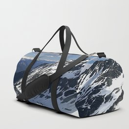 Mountains dappled with snow and rock Duffle Bag