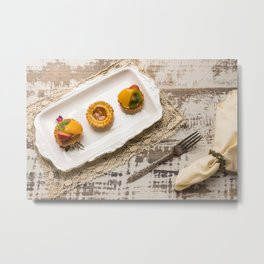 Three fruit tarts presented on an elegant antique china plate Metal Print