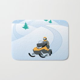 Snowmobiling on a Snowy Winter Day Bath Mat