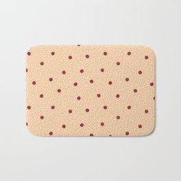 Polka dots and dashes // peach and burgundy Bath Mat