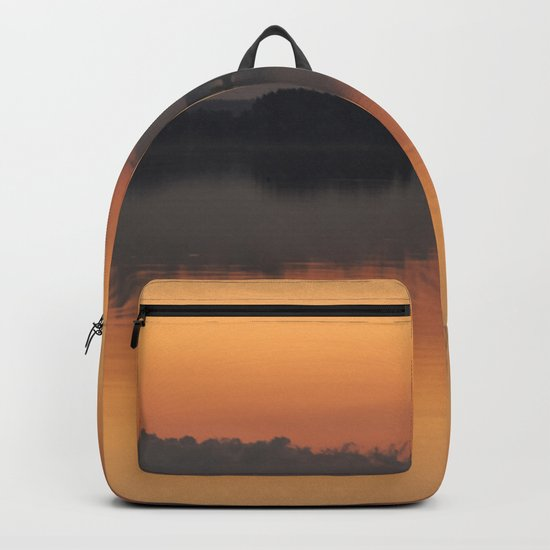 Sunset colors and reflection on the lake surface - magical atmosphere in Scandinavian night Backpack