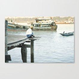 Birmese man sitting on a pier on the Yangon River, Myanmar Canvas Print
