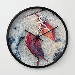Coralline algae and dead leaf on sand Wall Clock