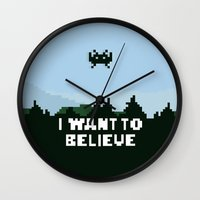 i want to believe Wall Clocks featuring i want to believe. by dann matthews