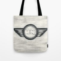 mini cooper Tote Bags featuring Mini Cooper Logo by SummerIllustrations
