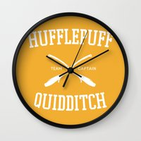 hufflepuff Wall Clocks featuring Hogwarts Quidditch Team: Hufflepuff by IA Apparel