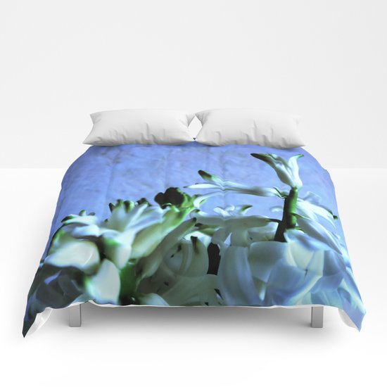 white hyacinthe on light blue background Comforters