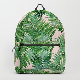 Green palm leaves on a light pink background. Backpack