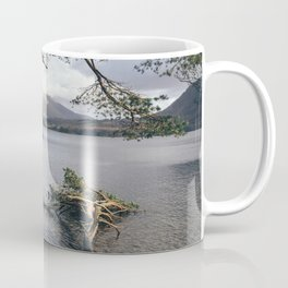 Sunlit tree roots on the shore of Derwent Water. Cumbria, UK. Coffee Mug