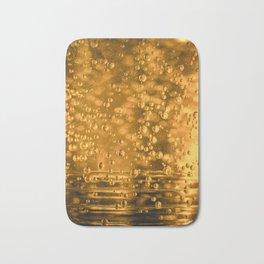 Golden water bubbles closeup macro with blurry effects Bath Mat