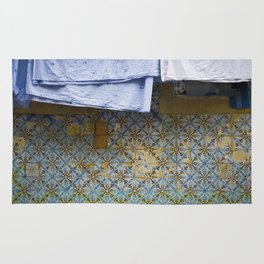 {clothes hanging} Rug
