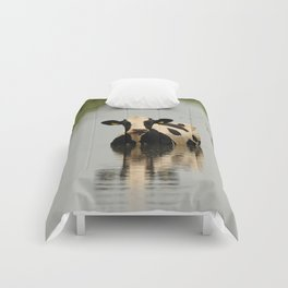 Cow in a channel Comforters