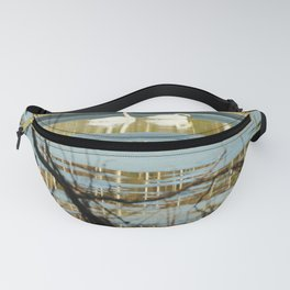 Swan couple on icy lake Fanny Pack