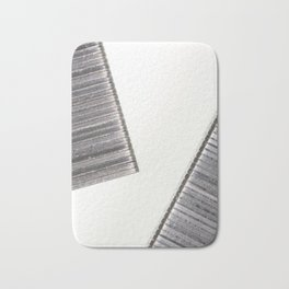 Abstract image composed of two office staples slats Bath Mat