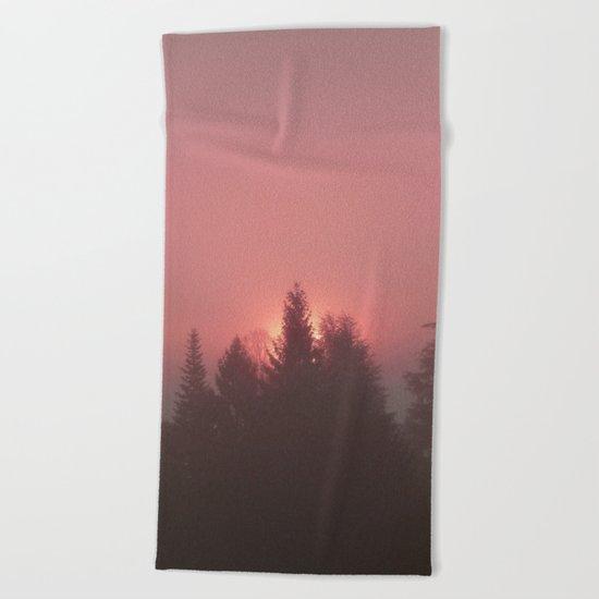 Sunrise on a foggy morning Beach Towel