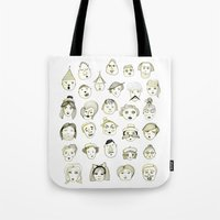 faces Tote Bags featuring Faces by Wood + Ink