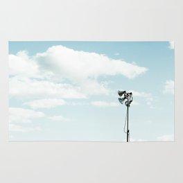 LED stadium light with blue cloudy sky Rug