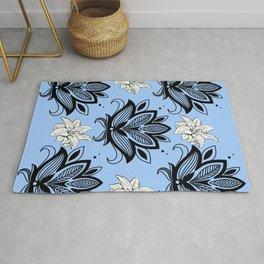 Black and White Floral Pattern Design on Blue Background Rug