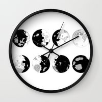 moon phases Wall Clocks featuring Moon Phases by jsemKamm