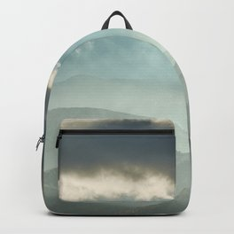Sunrise at the misty mountains. Backpack