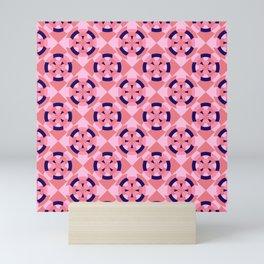 Simple geometric boat helm in blue and pink Mini Art Print