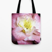beth hoeckel Tote Bags featuring Beth March - Pink Begonia by Regina Mountjoy